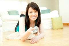 Brunette woman watching television Royalty Free Stock Photos