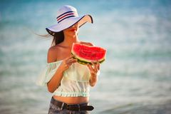 Brunette woman watermelon sea Royalty Free Stock Images