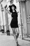 Brunette woman wearing black seductive dress in the street Royalty Free Stock Images