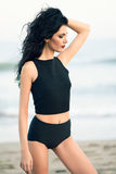 Brunette woman wearing black top and panties near a beach Royalty Free Stock Photos
