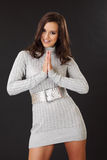 Brunette woman wearing braces and praying Royalty Free Stock Photo