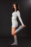 Brunette woman wearing grey dress and leggings Royalty Free Stock Photography