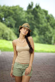 Brunette woman wearing hat in sunny day Stock Photography