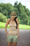 Brunette woman wearing hat in sunny day Stock Images