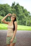 Brunette woman wearing hat in sunny day Royalty Free Stock Image