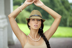 Brunette woman wearing hat in sunny day Royalty Free Stock Photography