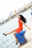Brunette woman wearing orange short dress in a harbor Stock Photography