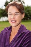 Brunette Woman Wearing Purple Top Outdoors Royalty Free Stock Image
