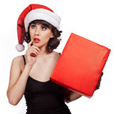 Brunette woman wearing santa hat Royalty Free Stock Photo