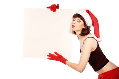 Brunette woman wearing santa hat Stock Photo