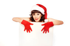 Brunette woman wearing santa hat Royalty Free Stock Images