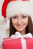 Brunette woman wearing santa hat Royalty Free Stock Image