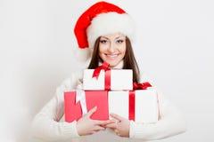 Brunette woman wearing santa hat Royalty Free Stock Images