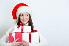 Brunette woman wearing santa hat Stock Photo