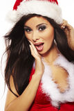 Brunette woman wearing sexy santa claus cl Stock Photos