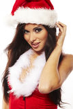 Brunette woman wearing santa claus cl royalty free stock image