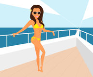 Brunette woman wearing yellow swimsuit is posing Stock Photo