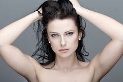Brunette woman with wet hair beauty royalty free stock photo