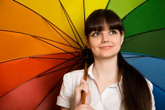 Brunette woman in white blouse with umbrella Royalty Free Stock Image