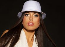 Brunette woman in white hat Royalty Free Stock Photo