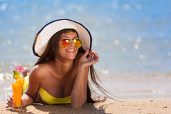 Brunette woman white hat drink cocktail Stock Photos