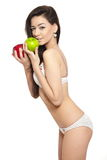 Brunette woman in white lingerie holding red apple Royalty Free Stock Photos