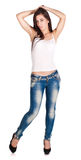 Brunette woman in white t-shirt and blue jeans Royalty Free Stock Image