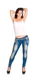 Brunette woman in white t-shirt and blue jeans Stock Images