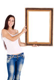 Brunette woman  wiht picture frame Royalty Free Stock Images