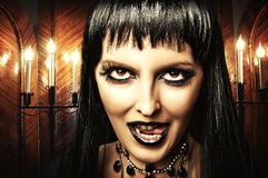 Brunette woman witch, Gothic make-up Stock Images