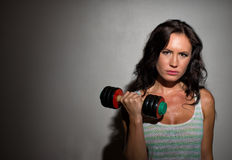 Brunette woman working out. Royalty Free Stock Photography