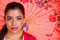 Brunette woman woth chinese umbrella royalty free stock photo