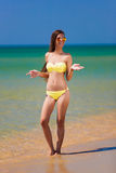Brunette woman yellow bikini sea Stock Image