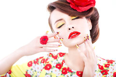 Brunette woman in yellow and red dress with poppy flower in her hair, poppy ring and creative nails, closed eyes. On white background royalty free stock images
