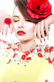 Brunette woman in yellow and red dress with poppy flower in her hair, poppy ring and creative nails, closed eyes Royalty Free Stock Photos