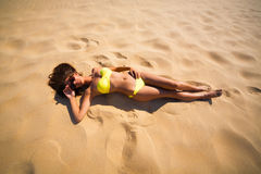 Brunette woman yellow swimsuit beach Royalty Free Stock Images
