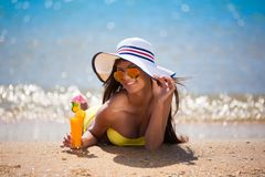 Brunette woman yellow swimsuit drink cocktail Royalty Free Stock Photography