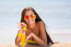 Brunette woman yellow swimsuit drink cocktail Royalty Free Stock Photos