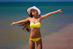 Brunette woman yellow swimsuit sea Royalty Free Stock Photo