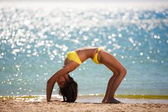 Brunette woman yellow swimsuit sea Royalty Free Stock Photography