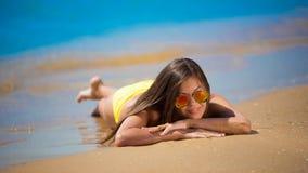 Brunette woman yellow swimsuit sea Royalty Free Stock Image