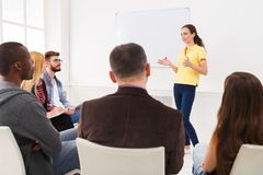 Brunette woman doing presentation in office. Brunette women doing presentation in office, copy space. Startup business meeting, sharing new ideas to partners stock images