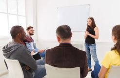 Brunette woman doing presentation in office. Brunette women doing presentation in office, copy space. Startup business meeting, sharing new ideas to partners stock photo