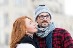 Brunette woman going kissing man. Red hair woman looking to guys face. Portrait of happy couple. Bearded guy in glasses royalty free stock photography