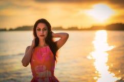 Brunette women in sea sunset scenery Royalty Free Stock Photos