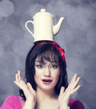 Brunette women with teapot on head. Stock Images