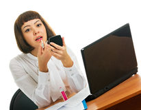 Brunette at work. A girl dyes lips Royalty Free Stock Photography