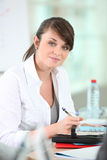 Brunette writing in agenda Royalty Free Stock Photography