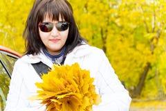 Brunette in yellow autumn Stock Photos