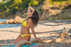 Brunette in yellow bikini Stock Photos